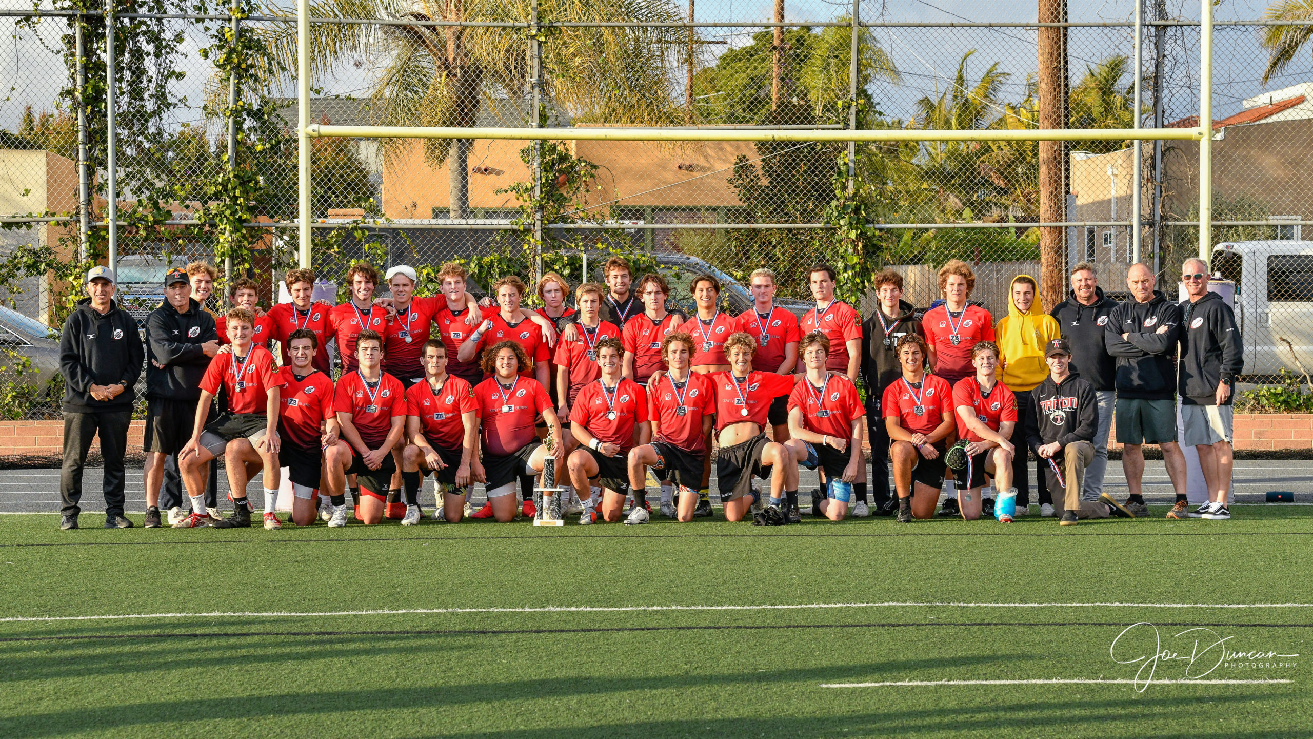 Team photo after the SCIRF varsity championship game between the St. Augustine Saints and the San Clemente Tritons on February 22, 2020.